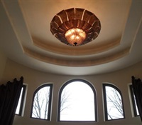Big chandelier installed on a 25' ceiling, with a lift. Old Westbury, NY