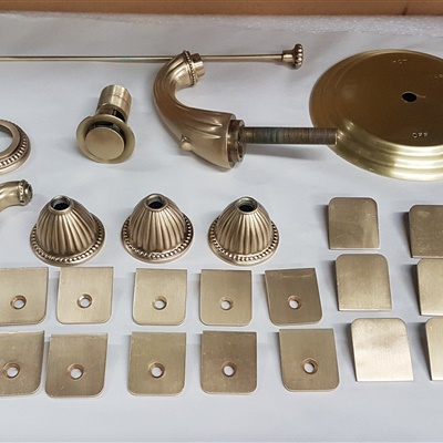 All these bathroom pieces were refinished in satin brass with a layer of clear coat to protect finish from water and steam.