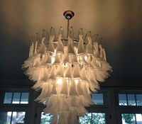 Chandelier with clear & whtie glasses installed over dinning room table. Greenwich, CT.