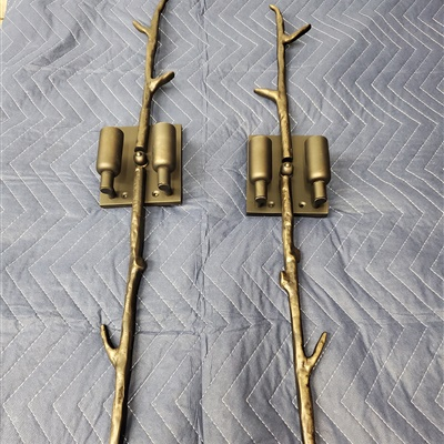 This sconces were refinished in Dark Pewter from their original finish in Polished brass.