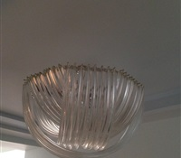 Chandelier cleaning with multiple layers of long curved glasses. Cleaned on site. West 86th. St. NYC.