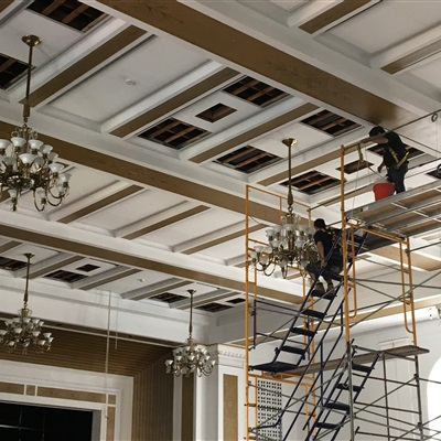 Putting up all the chandeliers after the cleaning and rewiring process.