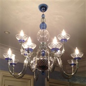 Unique glass chandelier installed flush on ceiling of NYC apt.