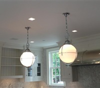 Pendants installed over kitchen bar in CT.