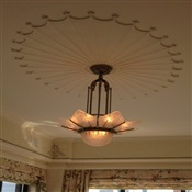 Chandelier installed flush on ceiling. NYC.