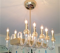 Small chandelier with 10 lights over dinning room table. CT.