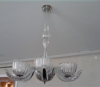 Glass chandelier installed flush over dinning room table on low ceiling apt. Upper west side. NYC.