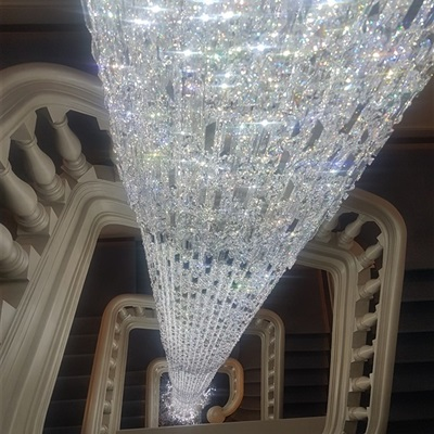 Cleaning of huge Cascade chandelier with Swarovski crystal by Vincent Van Duysen.