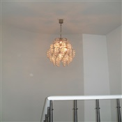 Fixture with hanging glasses installed over stairwell. New Jersey.